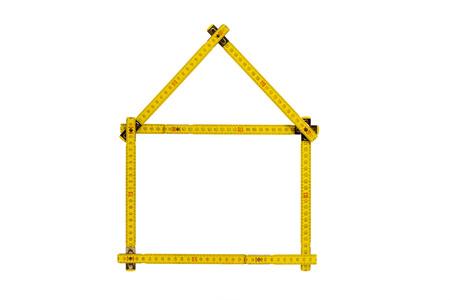 Maßstab gefaltet in Form eines Hauses