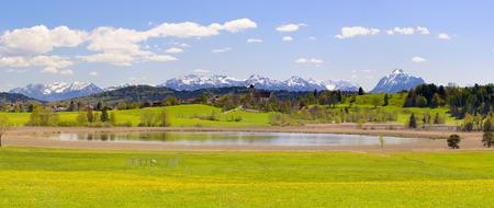panoramic scene in Bavaria with lake and mountain range