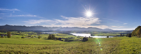 panoramic scene at Bavarian alps mountain range and lake Riegsee