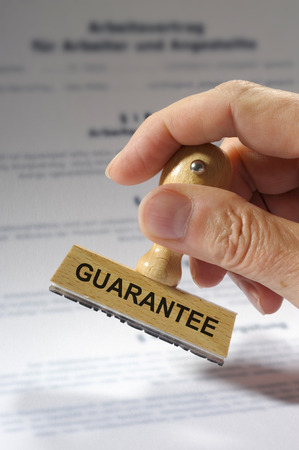 Guarantee printed on rubber stamp Banque d'images