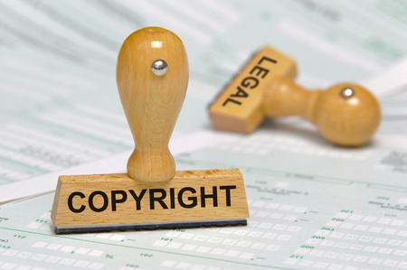 copyright and legal printed on rubber stamp Imagens