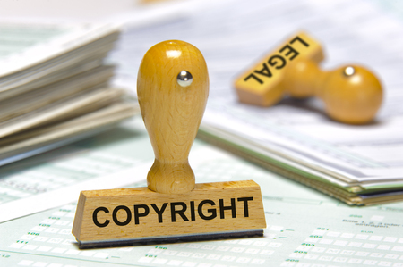 copyright and legal printed on rubber stamp Foto de archivo