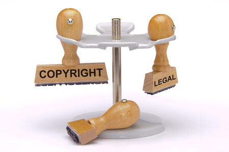 copyright and legal printed on rubber stamp Stockfoto