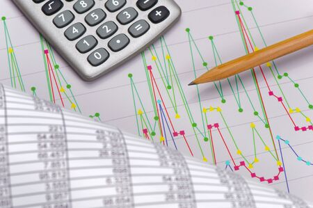 financial calculation with chart of stock market