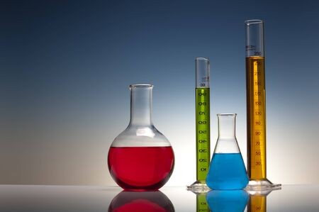 chemical experiment in laboratory with liquid in glassware