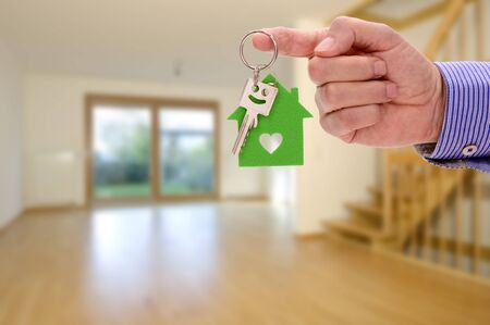 real estate agent holding room key in hand 免版税图像