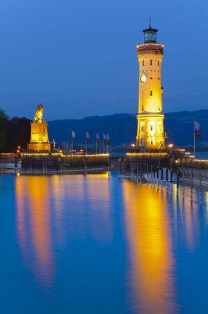 Illuminated towers at harbor of Lindau in Germany