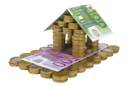 model home built with banknotes and coins of Euro currency
