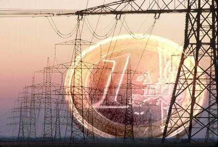 electrical pylons and Euro coin Banco de Imagens