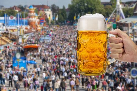 big traditional glass of Bavarian beer at Oktoberfest in Munich