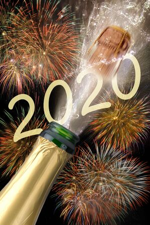Happy new year 2020 with firework and splashing bottle of champagne