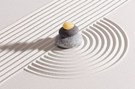 Japanes garden of meditation in sand with stone