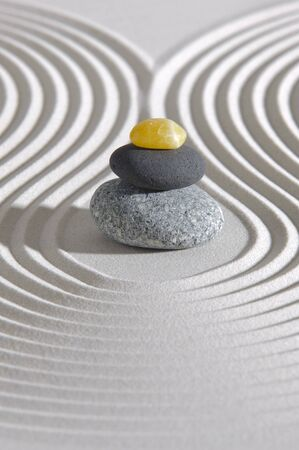 Japanes garden of meditation in sand with stone Stock Photo