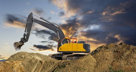 Excavator on a construction site Imagens