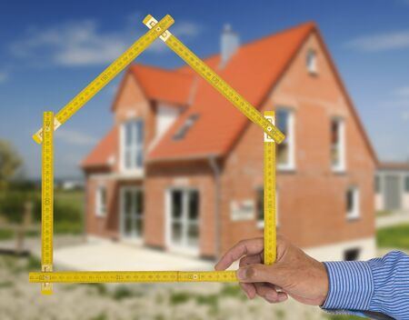 Real estate agent presents a newly built house for purchase