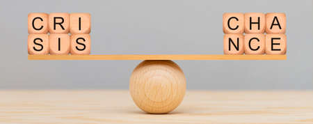 change and chance in balance over wooden ball