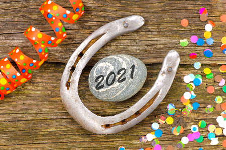 Happy new year 2021 with horseshoe as talisman