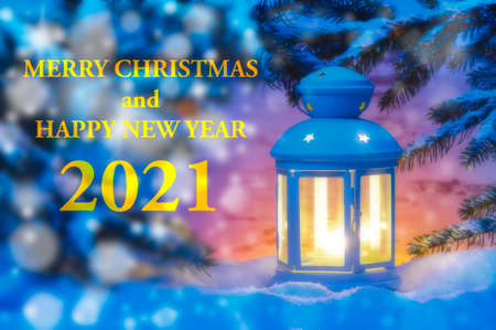 Happy new year 2021 with romantic lantern in snow