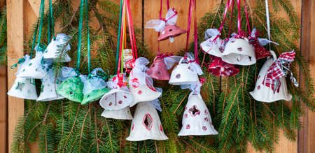 Romantic Christmas market with illuminated shops in wooden huts with gifts and handmade decoration. Imagens