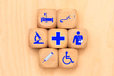 Medical care as a symbol on wooden cubes