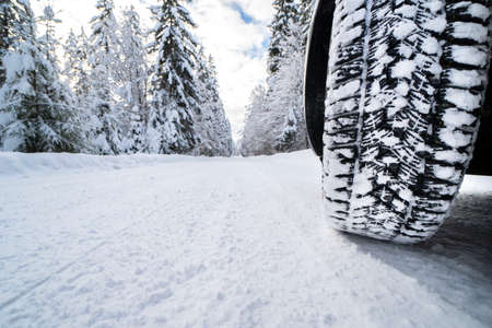 winter tires on snow covered road