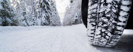 winter tires on snow covered road Reklamní fotografie
