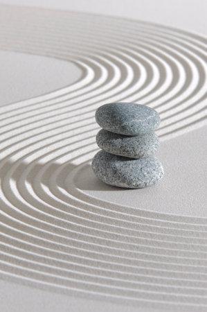 Japanese zen garden with stone in textured sand