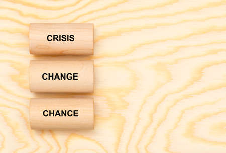 three pillars printed with crisis, change and chance