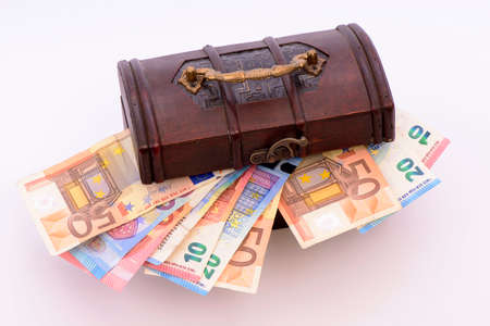 Euro banknotes lie in a treasure chest