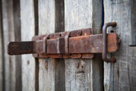 outhouse: rusty latch on outhouse