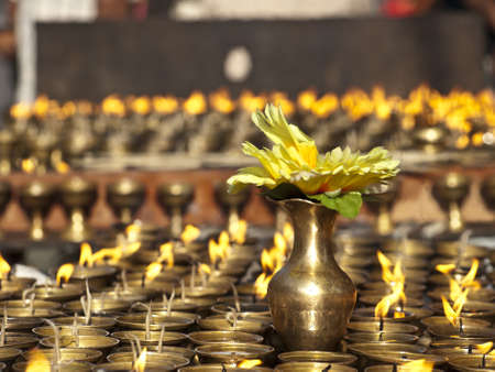 Vase on butter lamps in a temple of Katmandu valley, Nepal  Stock Photo - 17005484