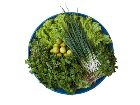 Various of green vegetable in a basket.