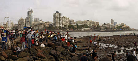 MUMBAI, INDIA - JULY 18, 2009: Local people celebrate the long weekend on the coast of Arabian sea in Mumbai, India. Mumbai is the central city of Indian financial city. Editorial