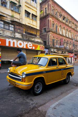 calcutta: KOLKATA, INDIA-APRIL 20, 2010: The classical ambassador cab is the unique style of taxi service that imported from British civilization in Kolkata, India.