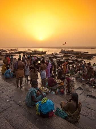 ghat: VARANASI, INDIA - APRIL 18, 2010: Crowding of local Indian people live their morning life with Ganga river in Varanasi, India. The most holy river of India and Hindu culture. Editorial