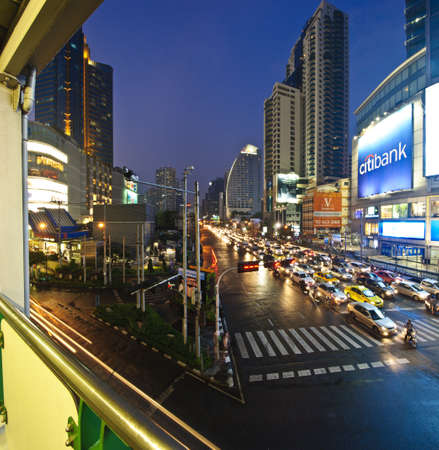 BANGKOK, THAILAND-FEBRUARY 2, 2012: The panorama view of traffic congestion on business Asoke junction in Bangkok, Thailand. Bangkok is the top 5 of most traffic congestion of the world. Stock Photo - 17227992