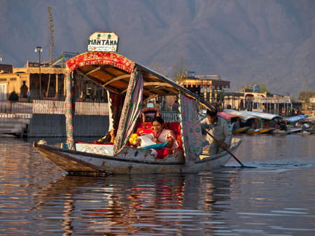 kashmir: KASHMIR, INDIA-APRIL 10, 2009: The unique decorative style of touring boat in Kashmir, India. People are to use Shikara for traveling and transportation in Dal lake. Editorial