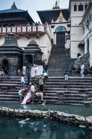 regarded: KATHMANDU, NEPAL-APRIL 16, 2010: Pashupatinath Temple, is regarded as one of the most important sacred places of pilgrimages for the followers of Hinduism in Kathmandu, Nepal.
