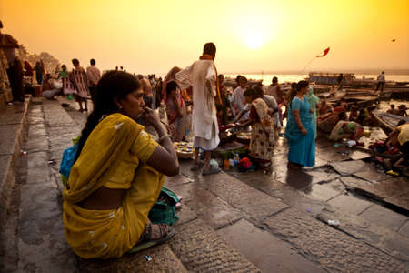 VARANASI, INDIA - APRIL 18, 2010: Crowd of local Indian live their morning life with Ganga river in Varanasi, India. The most holy river of India and Hindu culture. Editorial