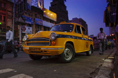 KOLKATA, INDIA-APRIL 8, 2010: The classical ambassador cab is the unique style of taxi service that imported from British civilization in Kolkata, India.