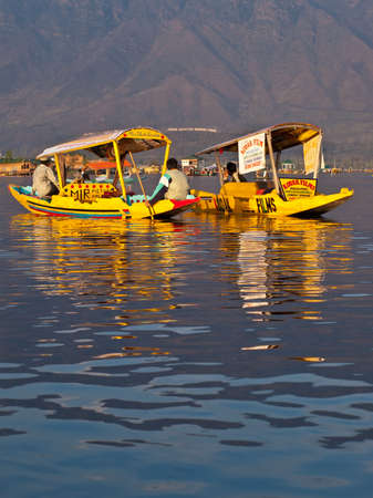 kashmir: KASHMIR, INDIA-APRIL 10: Dal lake, the tourist attractive destination in northern India. People use \ Editorial