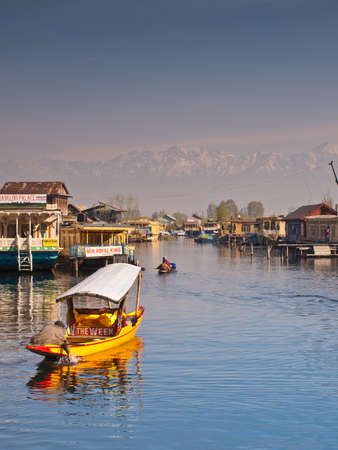 kashmir: KASHMIR, INDIA-APRIL 10: Dal lake, tourist attractive destination in northern India. People use Shikara for traveling and transportation in the lake on April 10, 2009 in Kashmir, India Editorial