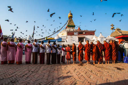 KATHMANDU NEPAL  APRIL 14: people celebrate around the great Bodhnath stupa on April 14 2010 in Kathmandu Nepal. The Buddhist religion monument is a renown architecture of Nepal.