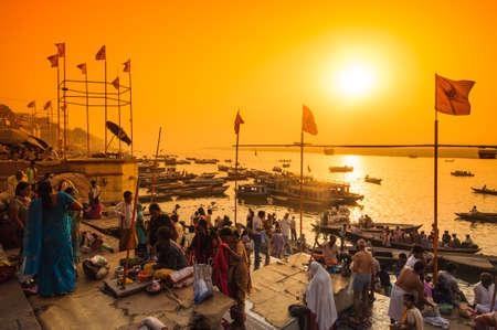 VARANASI, INDIA - APRIL 18: Crowd of local Indian live their morning life with Ganga river on April 18, 2010 in Varanasi, India. The most holy river of India and Hindu culture.