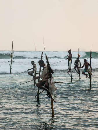 southern sri lanka: KOGGALA, SRI LANKA-OCTOBER 22: The local fishermen are fishing in unique style. The standing on the single timber pole can only found in this Indian ocean on October 22, 2009 in Koggala, Sri Lanka. Editorial