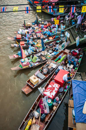 AMPHAWA,THAILAND-DECEMBER 22: Traders boats in Amphawa floating Market, 110 km from Bangkok, most famous floating market and cultural tourist destination on December 22, 2012 in Amphawa, Thailand. Editorial