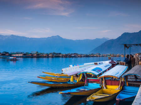 poverty india: KASHMIR, INDIA-APRIL 10: Dal lake, the tourist attractive destination in northern India. People use Shikara for traveling and transportation in the lake on April 10, 2009 in Kashmir, India Editorial