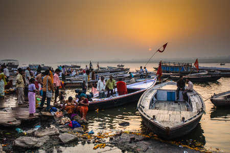 indian culture: VARANASI, INDIA - APRIL 18: Crowd of local Indian people live their morning life with Ganga river on April 18, 2010 in Varanasi, India. The most holy river of India and Hindu culture.