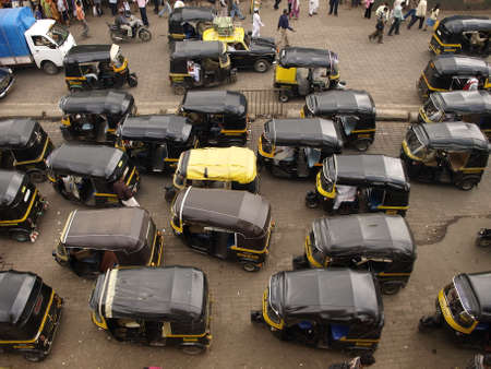 MUMBAI, INDIA-JULY 17: Traffic congestion on local street on July 17, 2008 in Mumbai, India. The classical auto rickshaw is the unique vehicle of local transportation in several Asian countries.