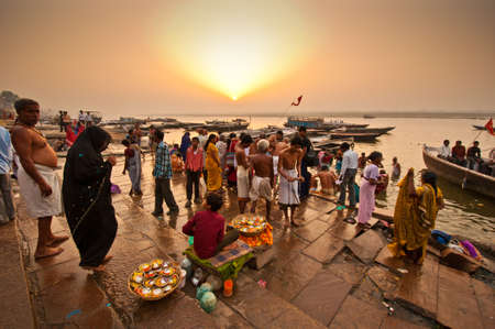 indian culture: Crowd of local Indian live their morning life with Ganga river on April 18, 2010 in Varanasi, India. The most holy river of India and Hindu culture.